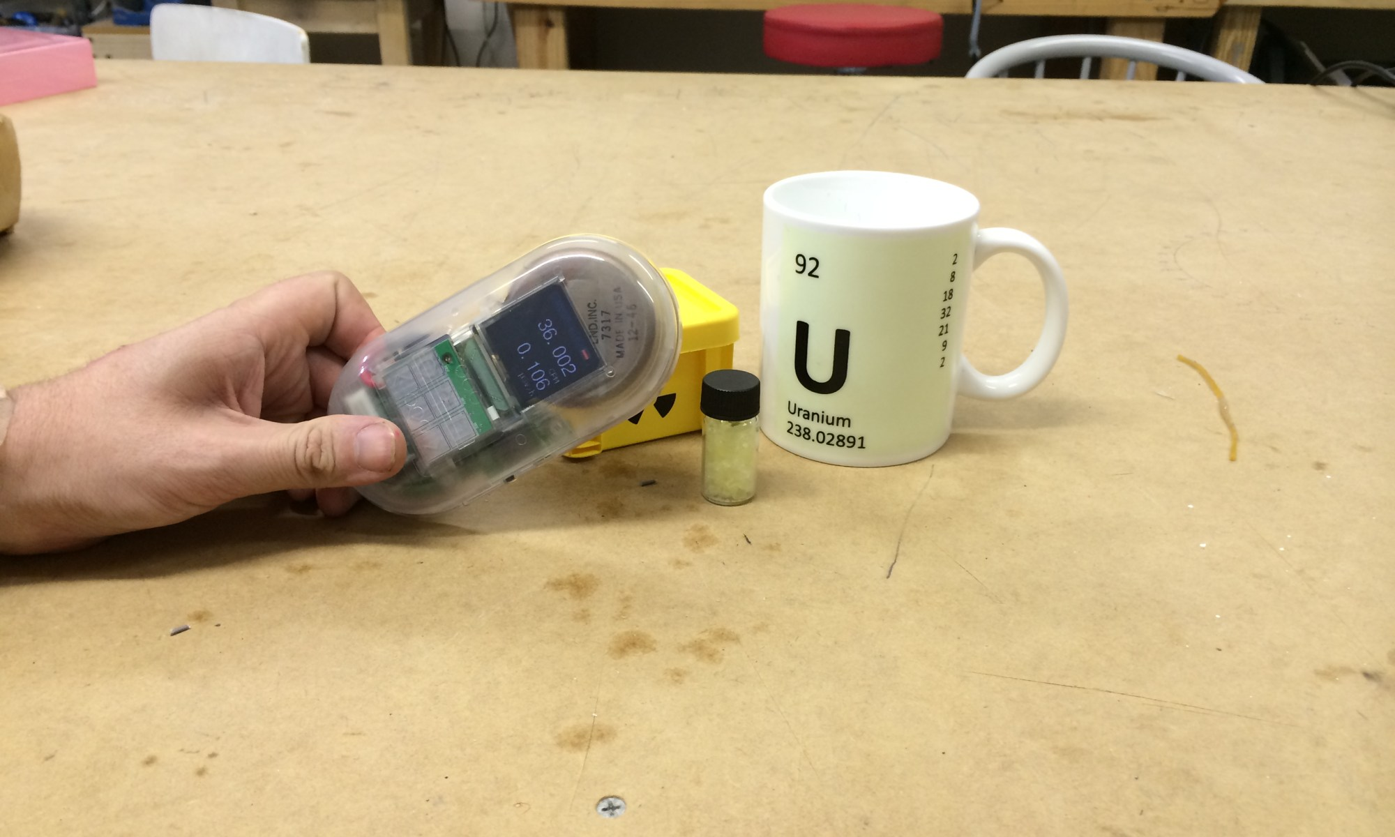 photo of a Geiger counter measuring the radioactivity of a mug