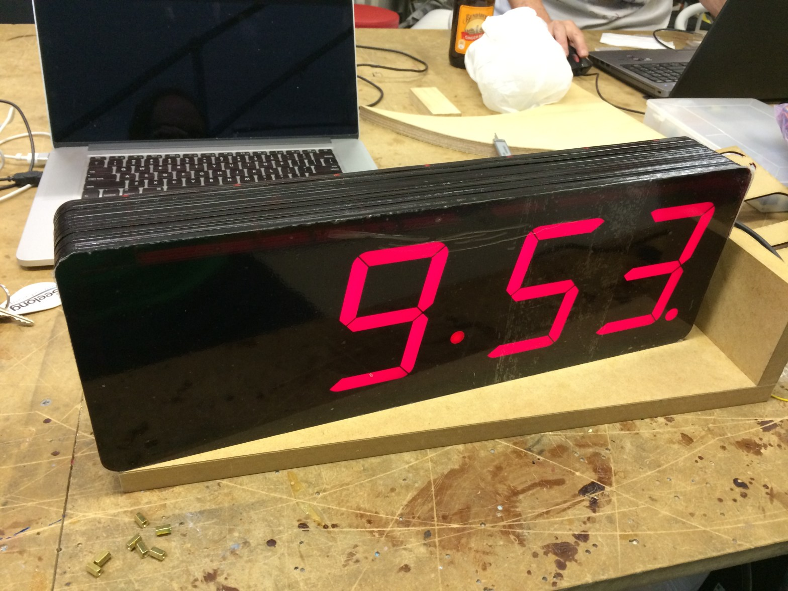 large 7 segment display clock showing 9:53 time
