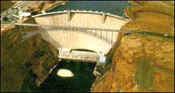 Glen Canyon Dam is a relic of the fabulous 50s, when such large scale projects were common. Should the dam be removed now that we know better? Photo: Dave Wegner/Glen Canyon Institute