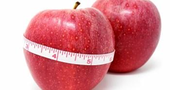 maçã com fita métrica