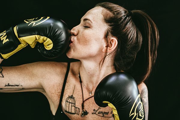 Girl boxer kissing her glove