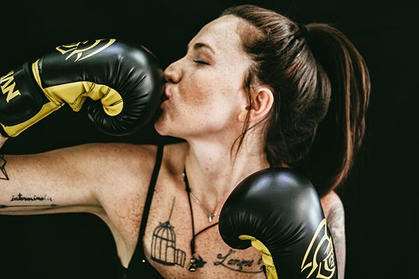 Girl boxer kissing her glove