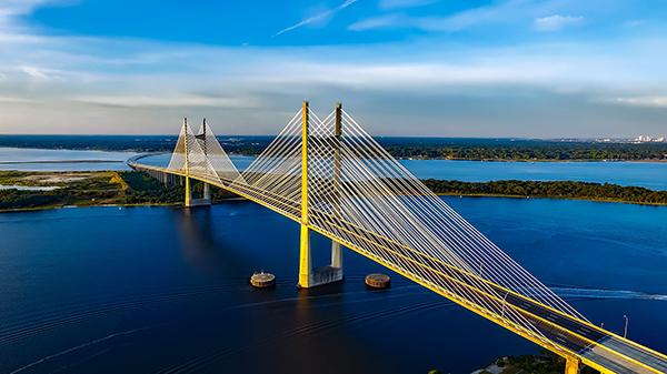 yellow suspension bridge across bay