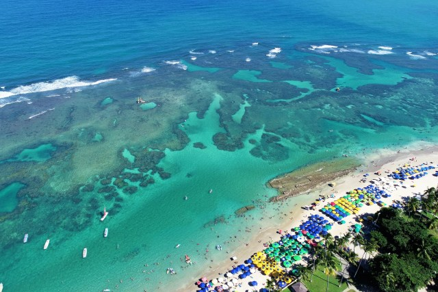 Aerial view Porto de Galinhas Beaches, Pernambuco, Brazil: unique experience of swimming in means to fish in natural pools. Fantastic vacation travel. Great beach scene. Beautiful landscape. Great travel destination.