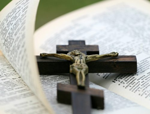 crucifix lying on bible