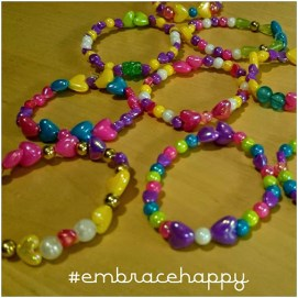 Embrace Happy beads for the party guests