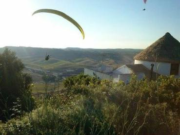 Paragliders over the countryside