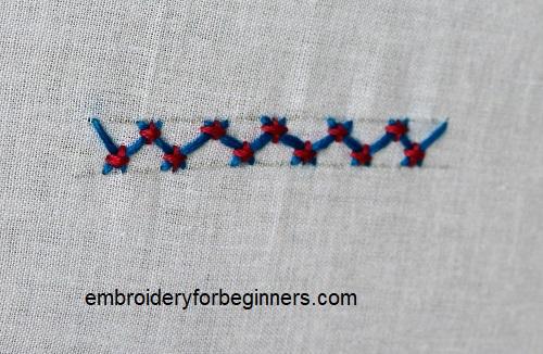 completed tacked herringbone stitch