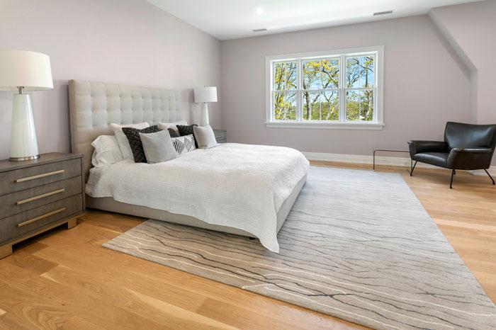 hardwood flooring installation in bedroom of Water Mill house