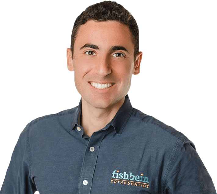 Dr. Fishbein of Fishbein Orthodontics smiling, straight white teeth, button up shirt with Fishbein logo