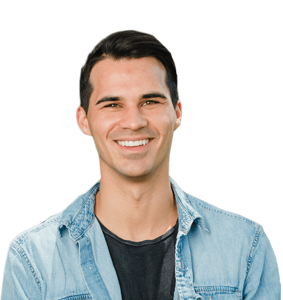 young man smiling, white straight teeth, blue denim button up, Fishbein Orthodontics