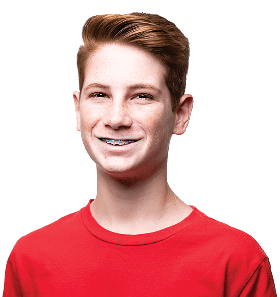 Young teenage boy, red hair, freckles, red shirt, smiling, braces, straight teeth Fishbein Orthodontics
