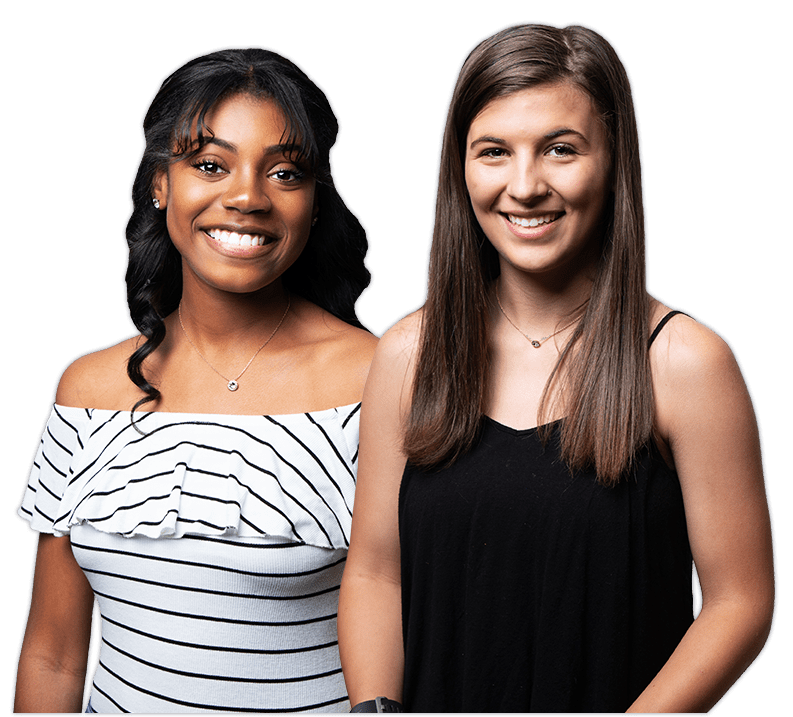 two young adult girls smiling with white, straight teeth, standing side-by-side