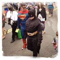 Adults dress up as super heroes.