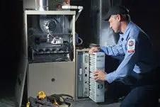 man working on furnace