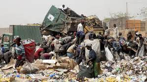 Poverty in Nigeria: Destitute Picking from Refuse