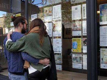 This image can be interpreted in a few ways. From its context in an article about how stressful buying a home can be for young couples, I see this image as a young couple embracing in fear over what they're about to undergo. Available at http://www.news.com.au/finance/real-estate/buying/housing-affordability-are-foreign-investors-to-blame-for-australias-high-property-prices/news-story/710ba2cff1932f0fb3f81ce83a07946b