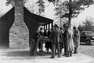 The director of the CCC gets an orientation from a park historian at the new Chancellorsville contact station