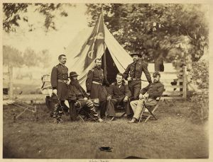 Maj. Gen. Phillip Sheridan, standing in he center underneath the guidon, surrounded by his subordinates. Courtesy of the Library of Congress.