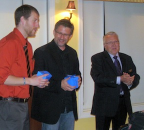 Phill (left) and I receive bright-blue boxes of what looks like Chinese take-out from Pete Rainey of the Wilderness Study group (they were actually beautiful crystal glasses).