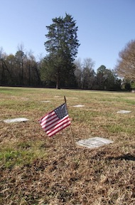 The headstones at Poplar Grove lay flush with the ground. (photo by Edward Alexander)