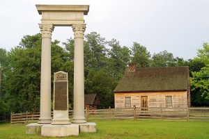 The Unity Monument with the replica of James Bennett's farmhouse in the background.