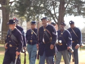 Living historians portraying USCTs marched along the Stage Road.