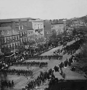The procession of Abraham Lincoln's hearse down Pennsylvania Avenue.  Military regiments followed Lincoln's body as it made its way to the Capitol.