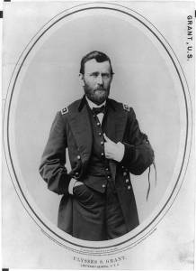 Taken in May of 1865, Ulysses S. Grant wears a mourning band in honor of Abraham Lincoln on his left arm.  The ribbons fastening it to his arm fall past is elbow.