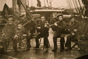 Men aboard the USS Wabash formed a minstrel group, and Henry Moore photographed them while in Port Royal