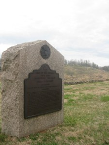 One of several monuments to the U.S. Regulars on Houck's Ridge. Little Round Top can be seen to the right.
