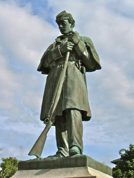The first Civil War figure to be erected in New Hampshire on the monuments envisioned in George Marden's letter of March 2, 1862. Of the 4882 New Hampshire soldiers who died in the Civil War, 1903 died in battle or from wounds battle, while 2427 were taken by disease. The above bronze statue, created by Martin Milmore, was unveiled in 1869 at a ceremony in Claremont.