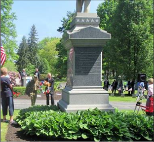 Laying a wreath at the monument on Memorial Day. (Image courtesy Ted Heineman)
