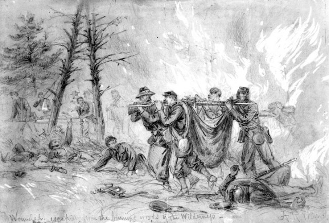 Rescuing the wounded from burning woods.JPG