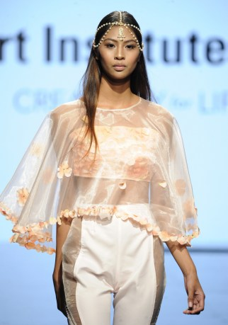 LOS ANGELES, CA - OCTOBER 12: A model walks the runway wearing Melynda Valera at Art Hearts Fashion Los Angeles Fashion The Art Institutes Showcase on October 12, 2016 in Los Angeles, California. (Photo by Arun Nevader/Getty Images for Art Hearts Fashion)