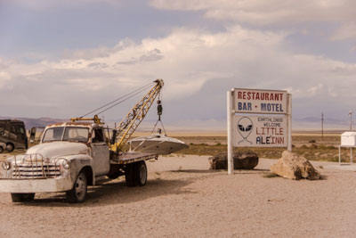 Photo of pickup truck with flying saucer in tow