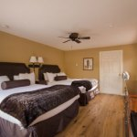 Photo of the bedroom in Room 115 at the Nordic Inn