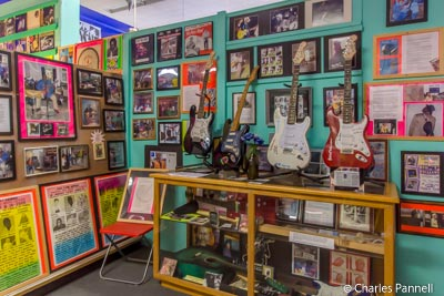 Signed guitars, concert posters, concert photos, and other memorabilia in the Rock and Blues Museum