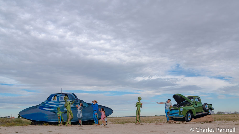 Roadside mural of aliens meeting Roswell locals