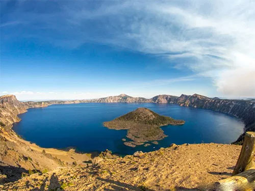 Photo of Wizard Island in Crater Lake's Deep Blue Waters