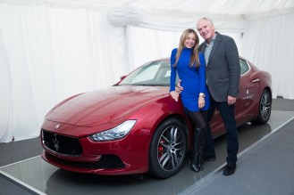 Thomas Borer and his wife with Maserati Ghibli