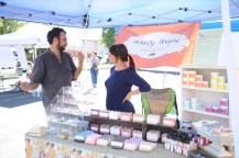 Rachel and Brian discuss her handmade soaps at the Orange Thyme booth.
