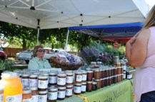 Bev from Petunia's Marketplace proudly displaying honey from her own apiary.