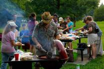 EGNC secretary Stan Burke lays out the hamburgers and hot dogs