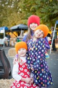 The younger shoppers model their new knit hats.