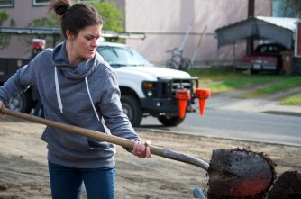 Jackie shovels some compost.