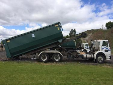Another dumpster arrives