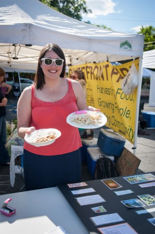 Amanda from the Main Market Co-op shows off their gourmet cheeses.