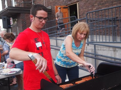 Grilling the free hot dogs