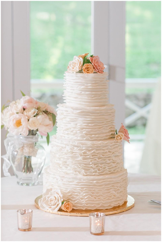 buttercream-four-tier-wedding-cake-blush-flowers-photo